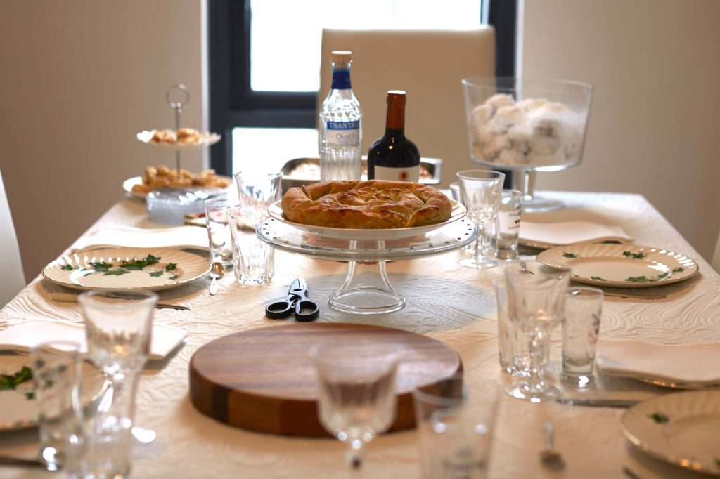 Peter Rowland Nonnas of Melbourne - Mary Calombaris setting dining table with beautiful china and glassware