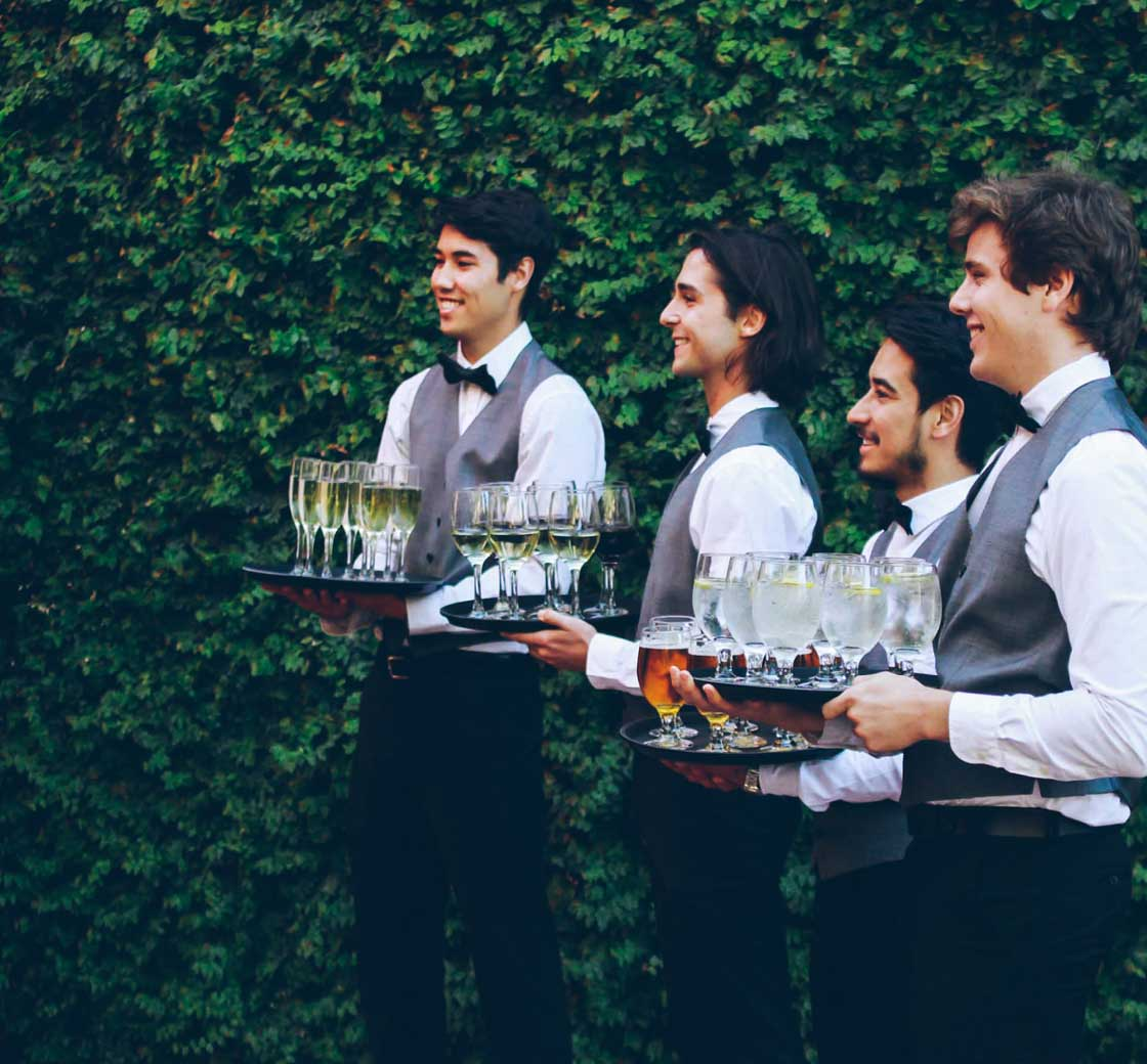 Waiters with drinks as part of our catering service