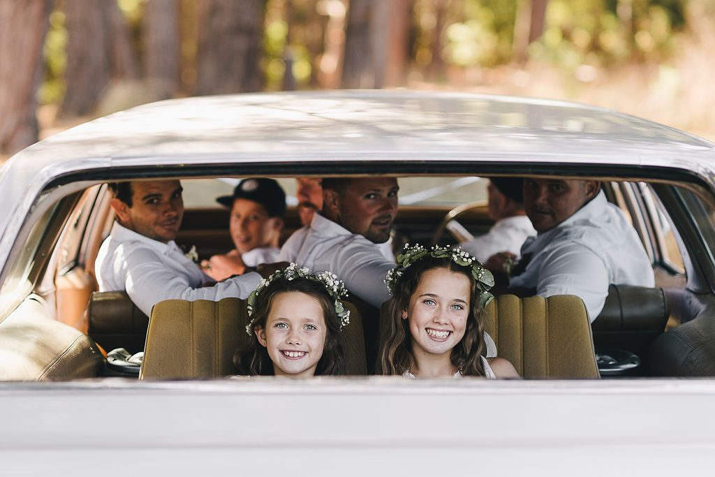 Wedding photography of family in car